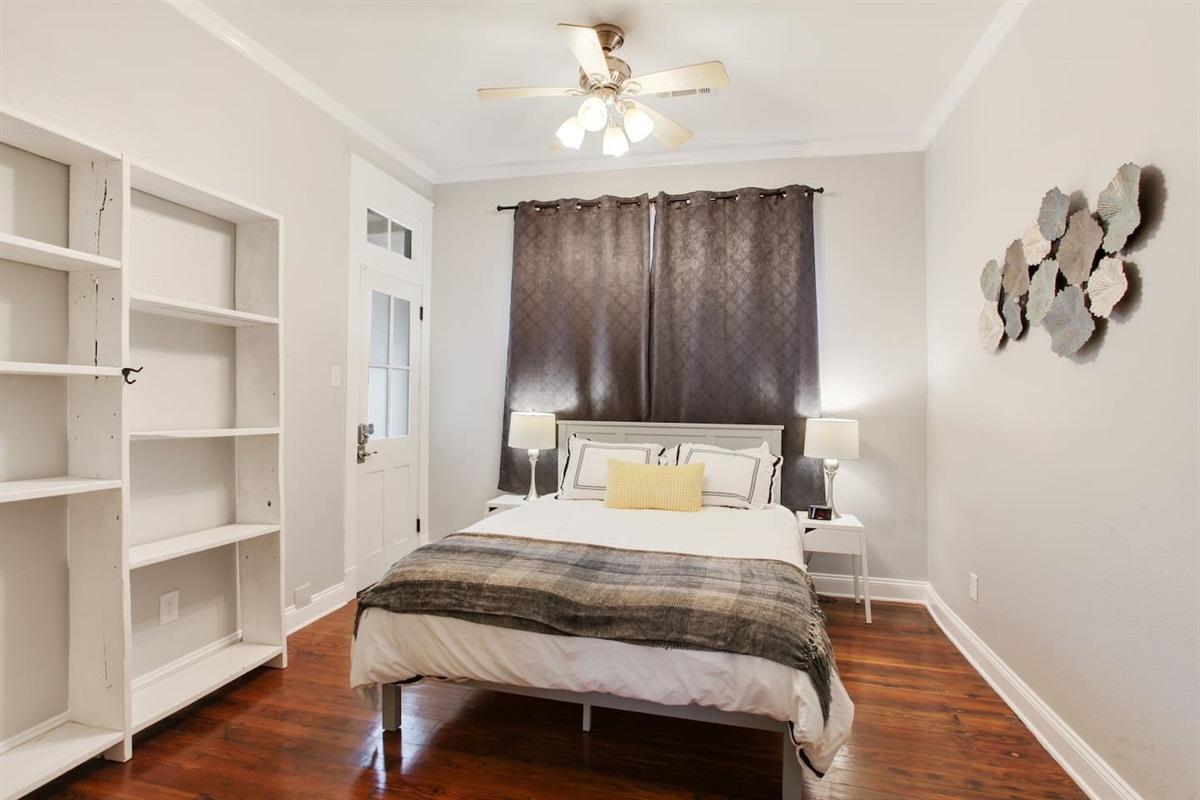 Bedroom 3. Queen bed. Memory foam gel mattress. Private patio access. Not pictured: closet.
