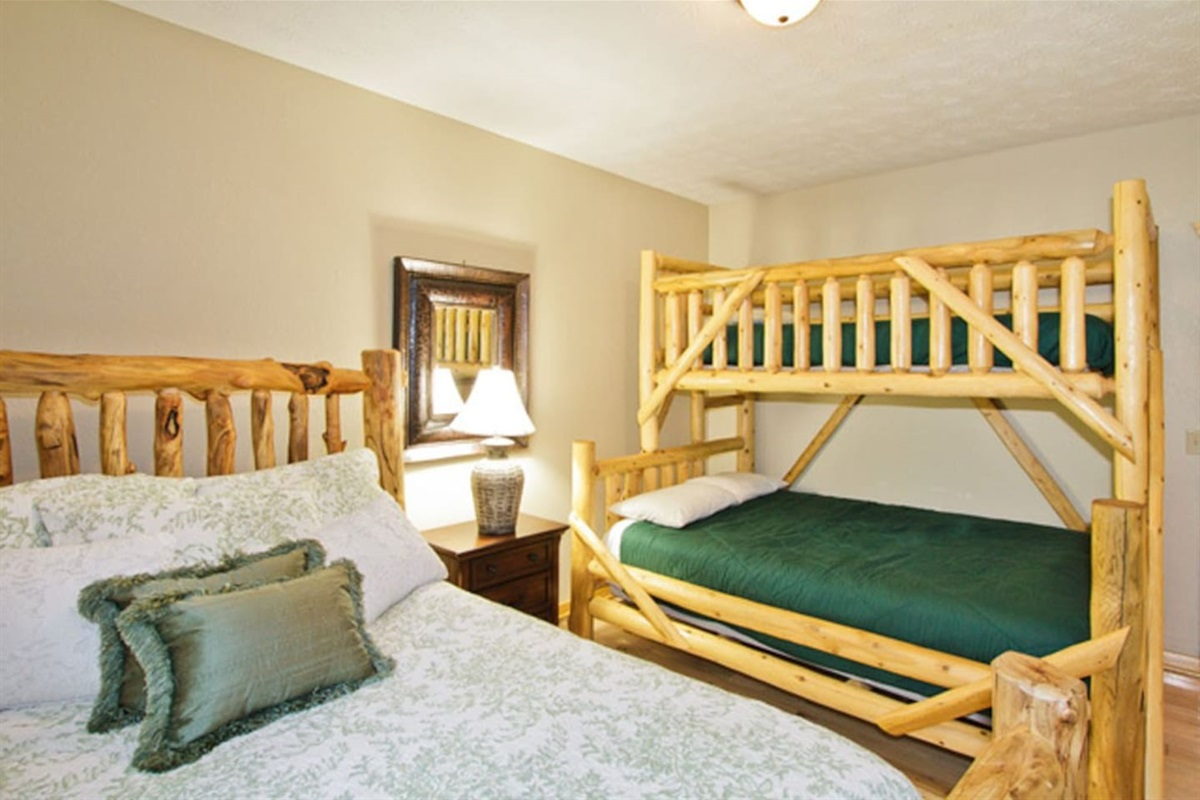 Family bedroom that can sleep five, with full bath outside bedroom door.