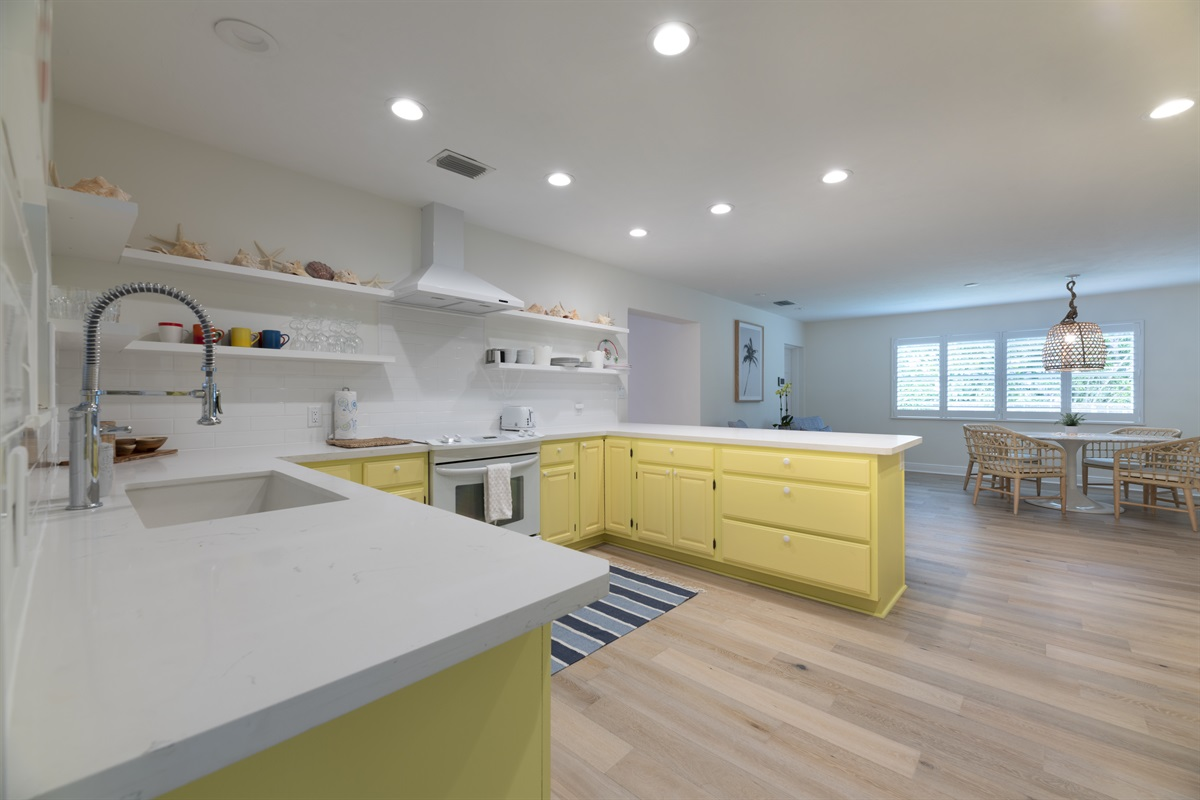 Bright and newly upgraded kitchen with everything you need to create that masterpiece meal! Great bar counter seating. Toaster, Blender, Microwave & coffee maker!