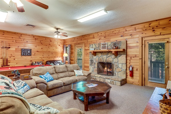 Lower level room with fireplace and pool table