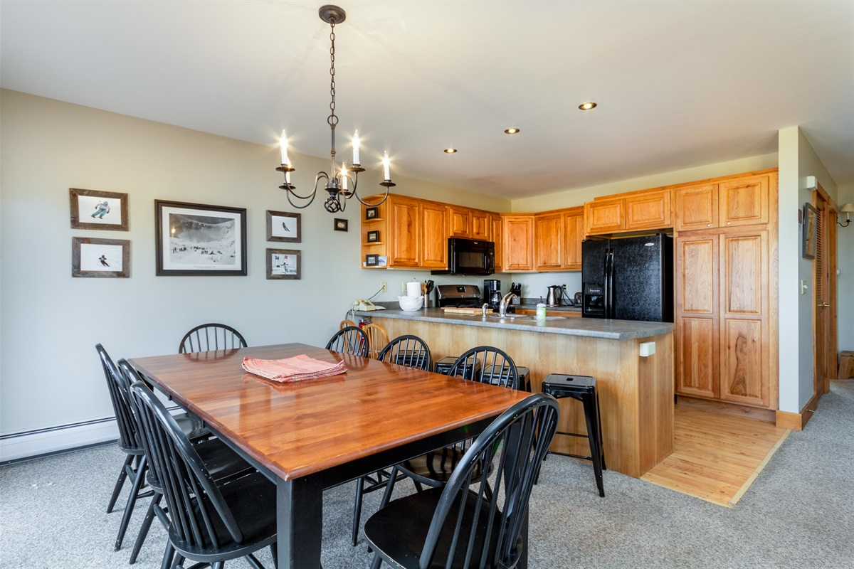 Large dining area and well stocked kitchen.