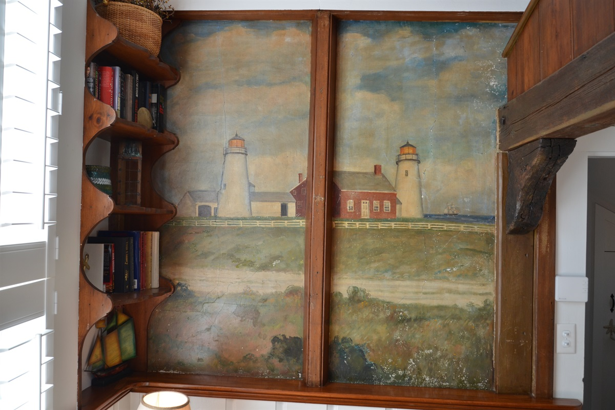 The Chatham Lighthouse station was first established in 1808. This mural depicts the original Chatham Twin Lights which were built 70 feet apart to distinguish Chatham's coastline from other towns when seen from the Atlantic. Long lost to erosion.