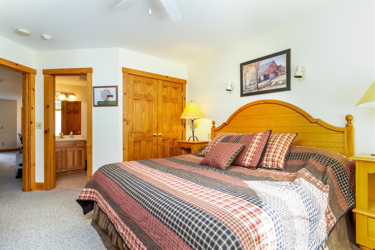 Large, sunny master suite with Kingsize bed and ensuite  bathroom, with shower and tub combo.