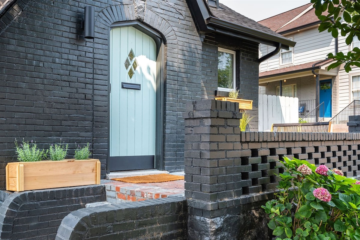 After parking in the private driveway or being dropped off from the airport (15 minutes away), you will enter the home through the nearly 100 year old refurbished door