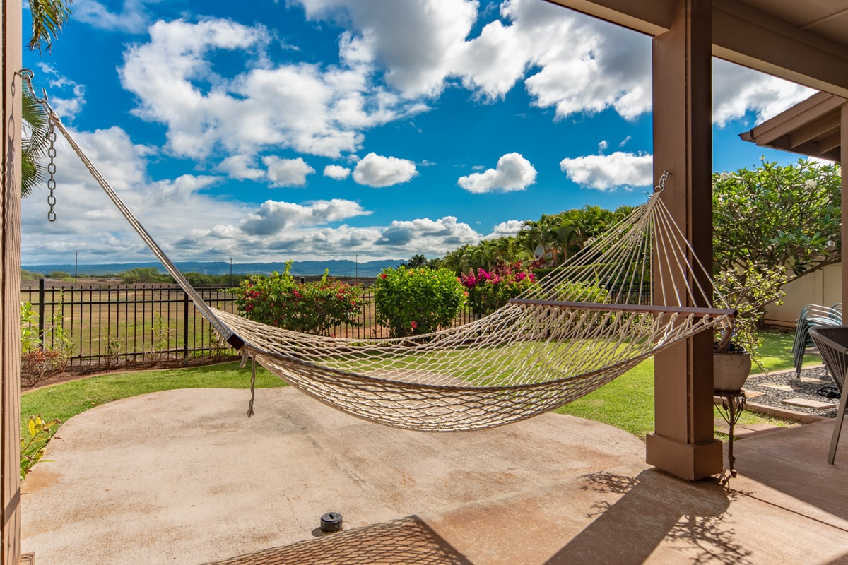 Unwind in the lace hammock as you watch the clouds drift by