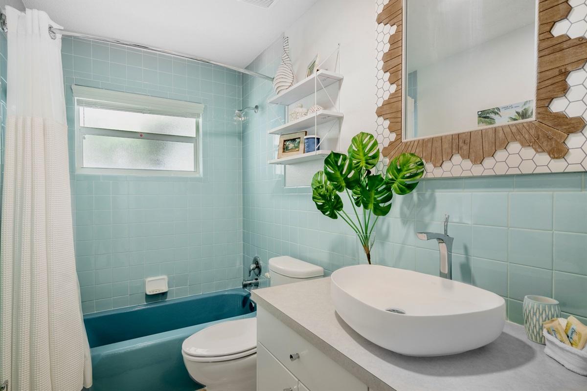Bathroom has restored 1960's vintage aqua blue tiles