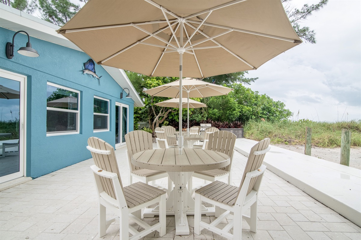High quality outdoor furniture with tables, chairs, & umbrellas.