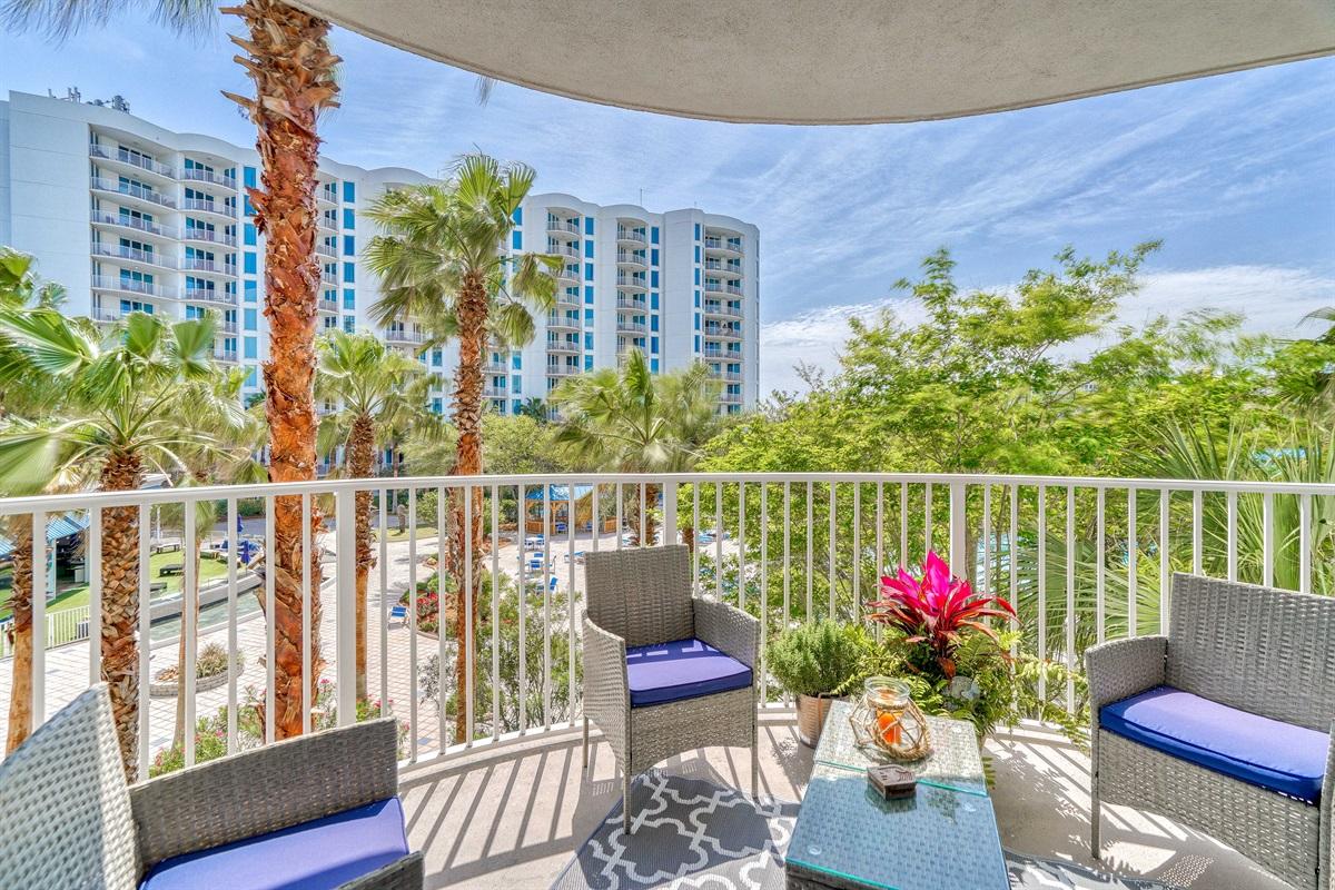 Cozy balcony overlooking pool deck