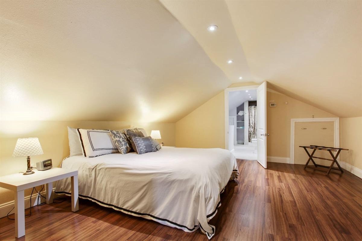 """Bedroom 4. Upstairs. Queen bed. En-suite bathroom. Not pictured: 40"""" antenna tv."""