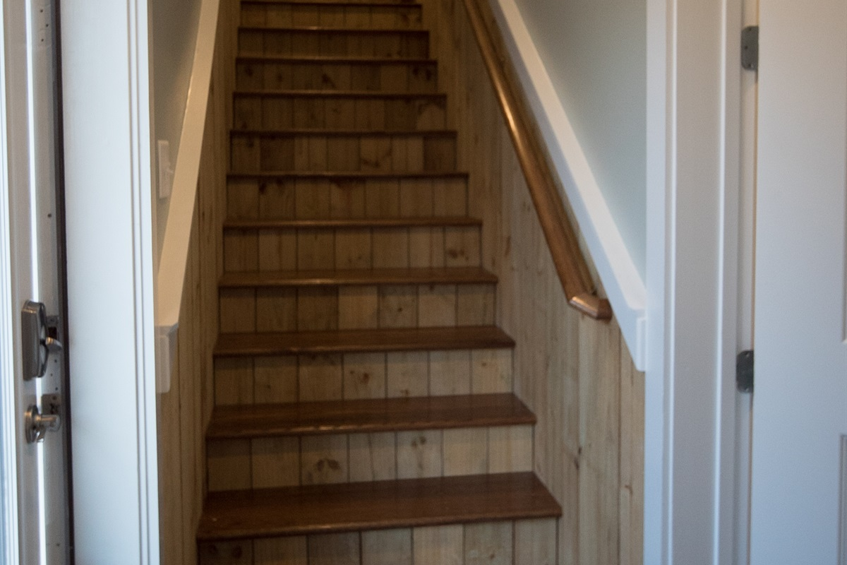 Stairs to the second level. Optional locking interior door allows for added privacy for the first level living space.