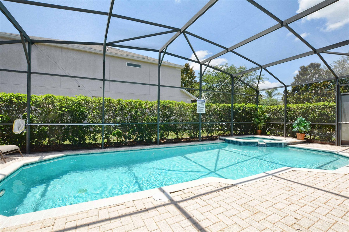 South facing saltwater pool & with hedges for privacy.