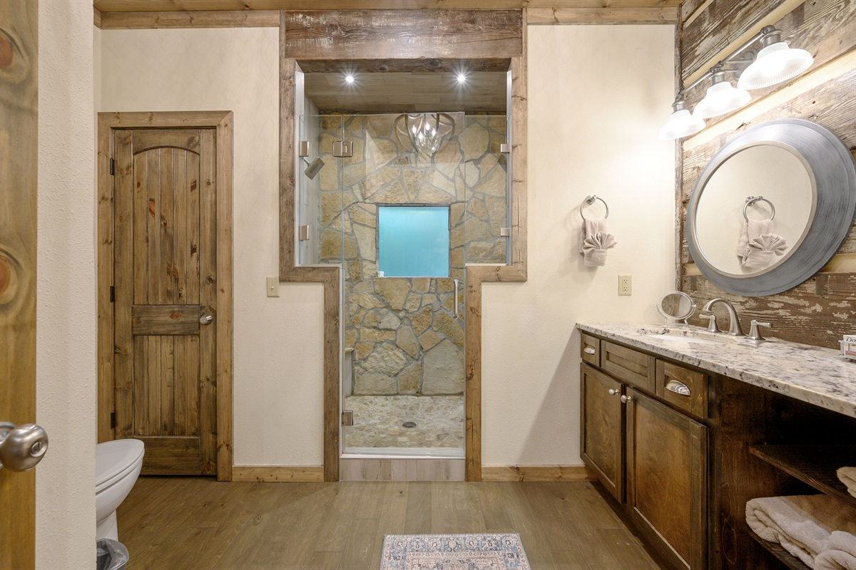 Master bath features a double sink vanity and oversized shower with a shower head on each end