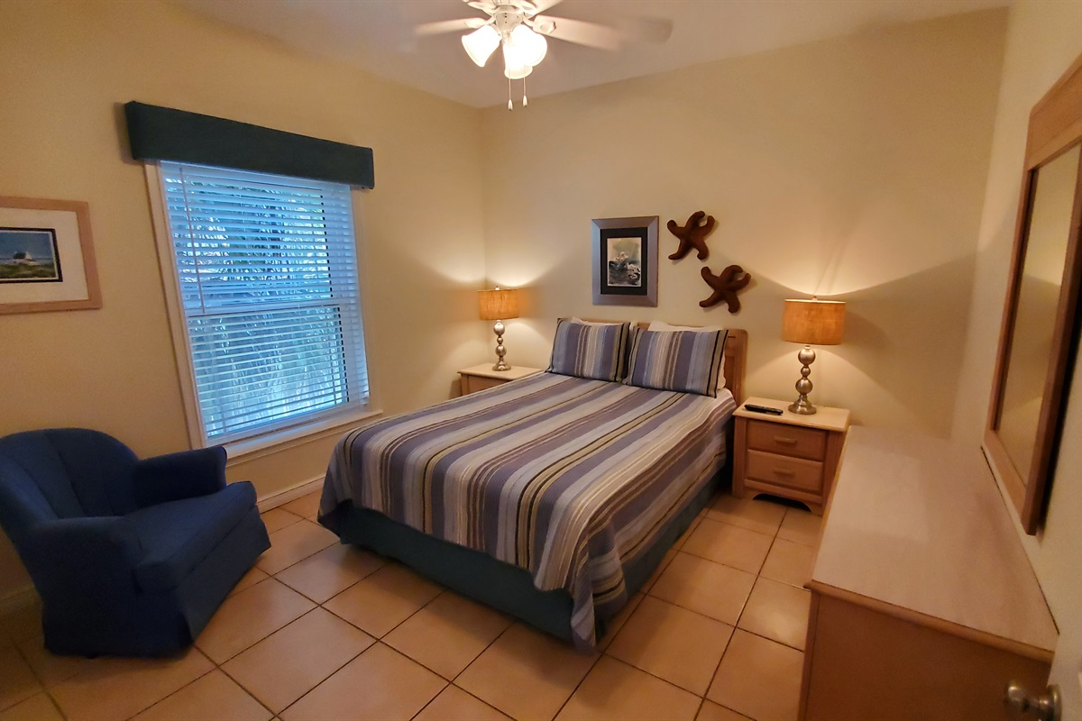 Queen Bedroom has private access to full hall bath with shower.