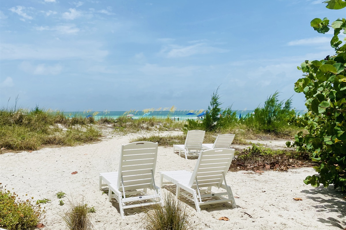 New chaise loungers on private beach of Sailfish Gulf Suites