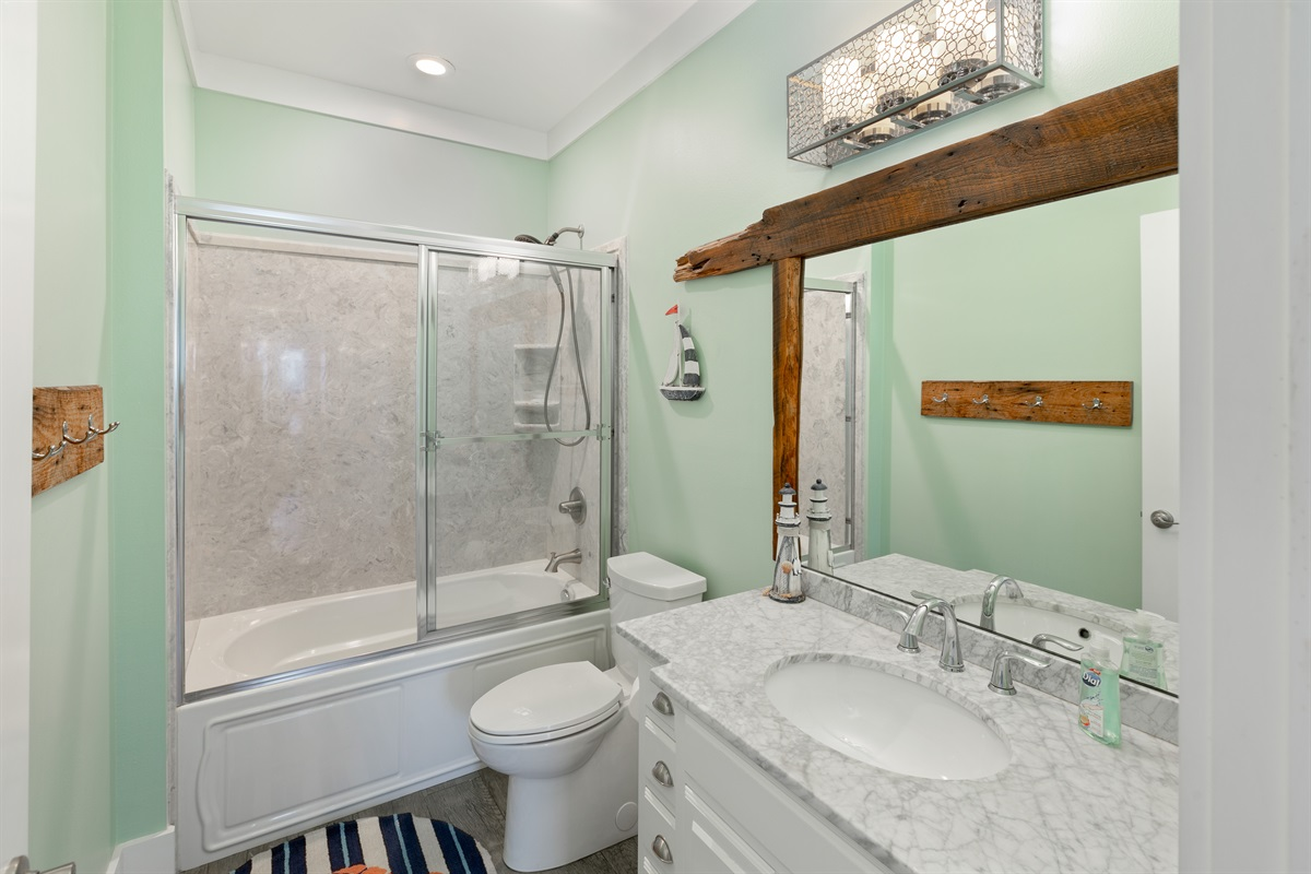 Third floor shared bathroom with shower/tub combo is utilized by the bunk rooms and common area.