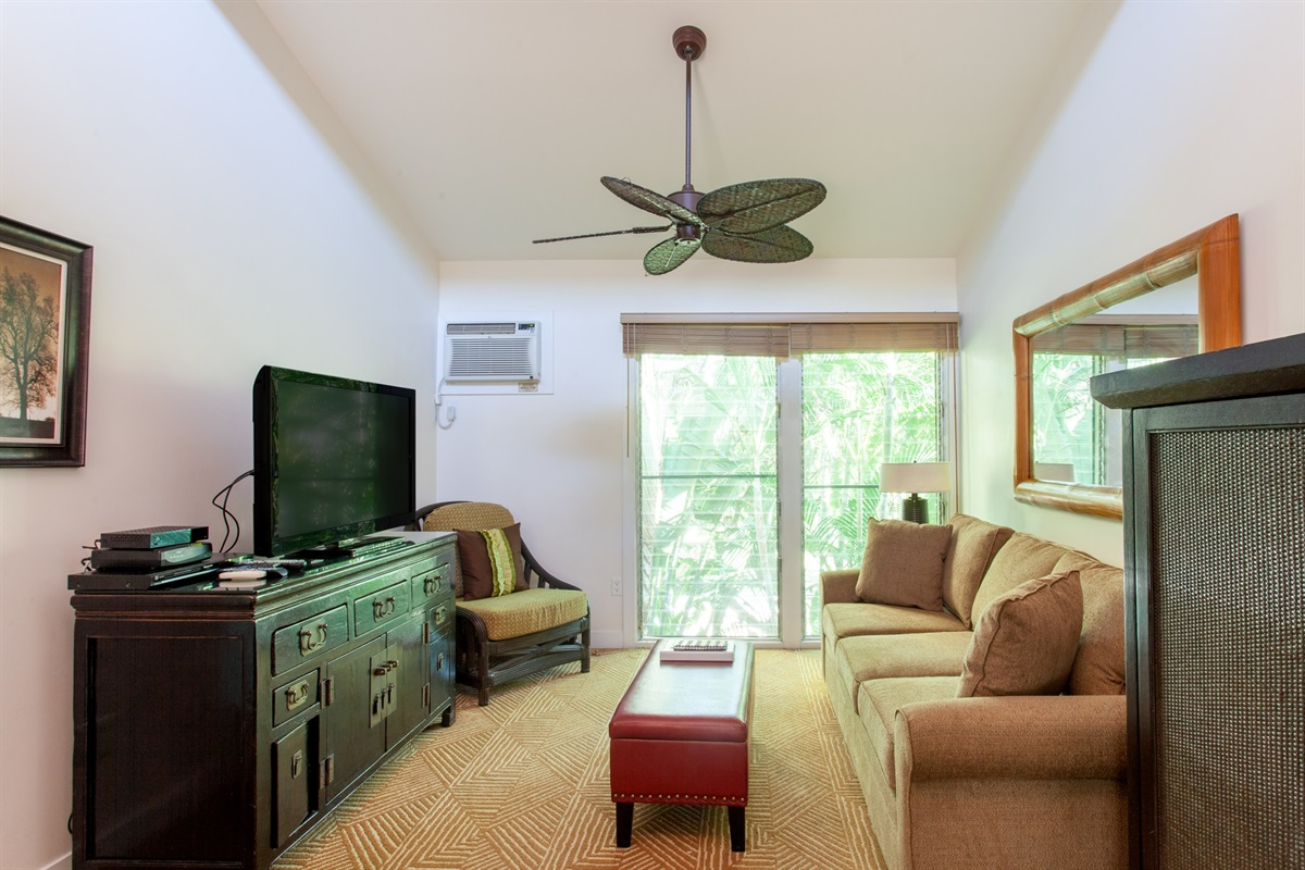 Living room with high ceilings is nice and bright