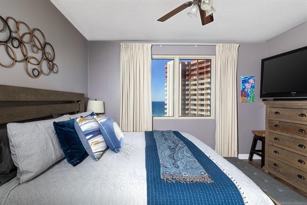 "Primary Bedroom w/ 50"" TV"