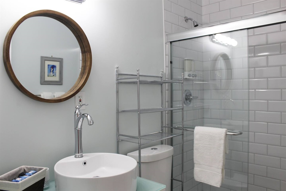 En suite master bathroom. This bathroom has a semi-frameless shower stall. Near the sink, you'll find organic moisturizer and hand soap. In each bathroom, you'll find Pinzon Blended Egyptian White Cotton Towels.