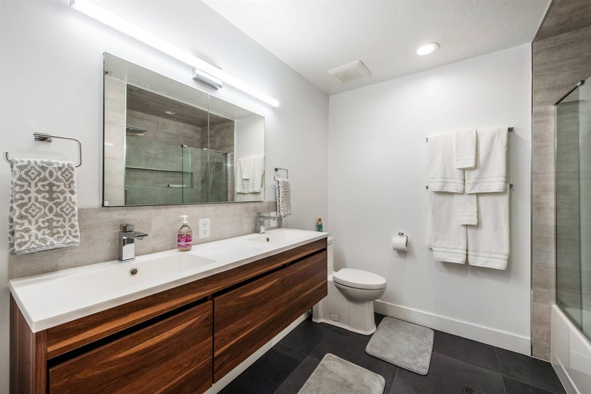 Beautifully remodeled bathroom.  Double vanity, combo tub / shower.