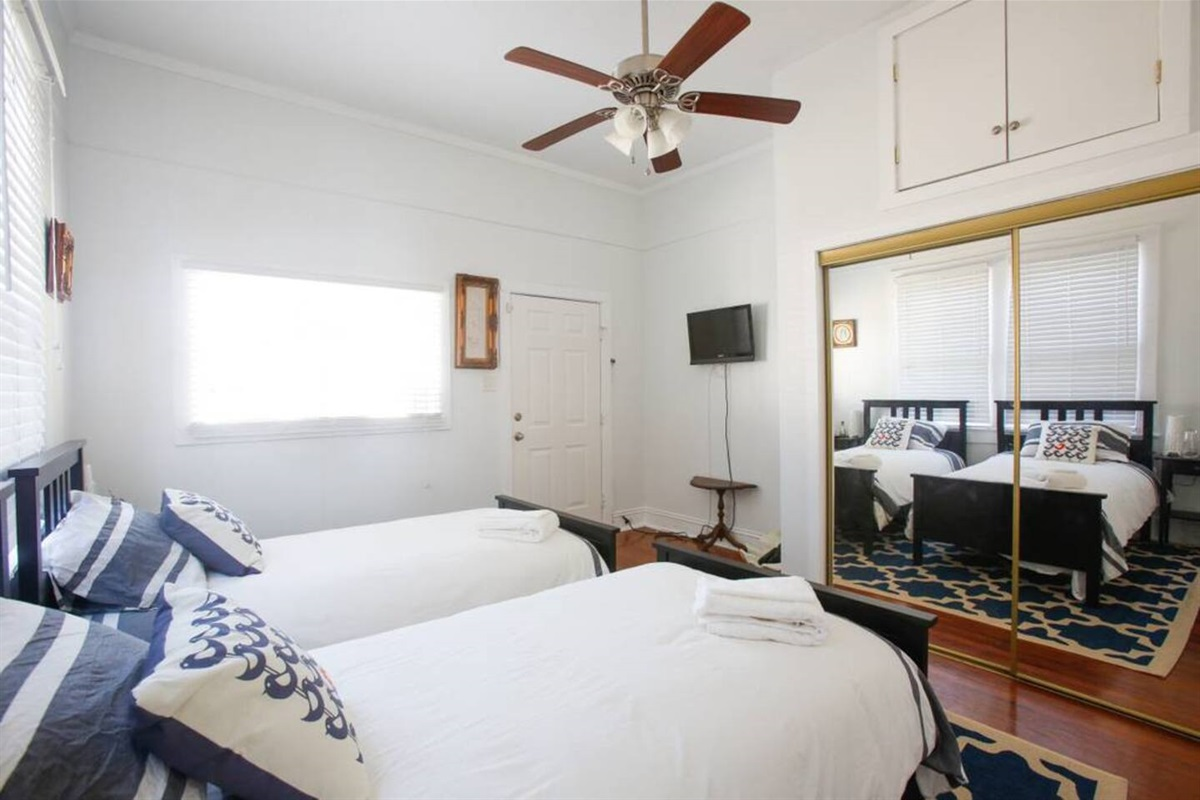 Twin bedroom.  Features a closet and cable tv. Accessible via an exterior door or the den.