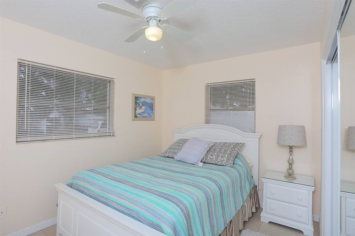 Queen bedroom with comfortable bed and large closet