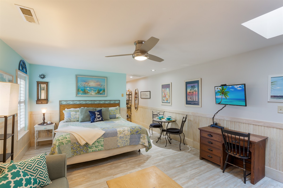 """Welcome to this """"Key West"""" themed condo, with large living space - kitchenette is to the right.  TV with Comcast Cable"""