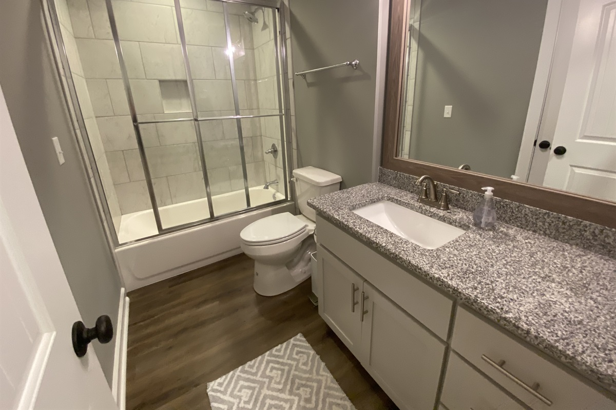 Guest Bathroom with stand up shower.