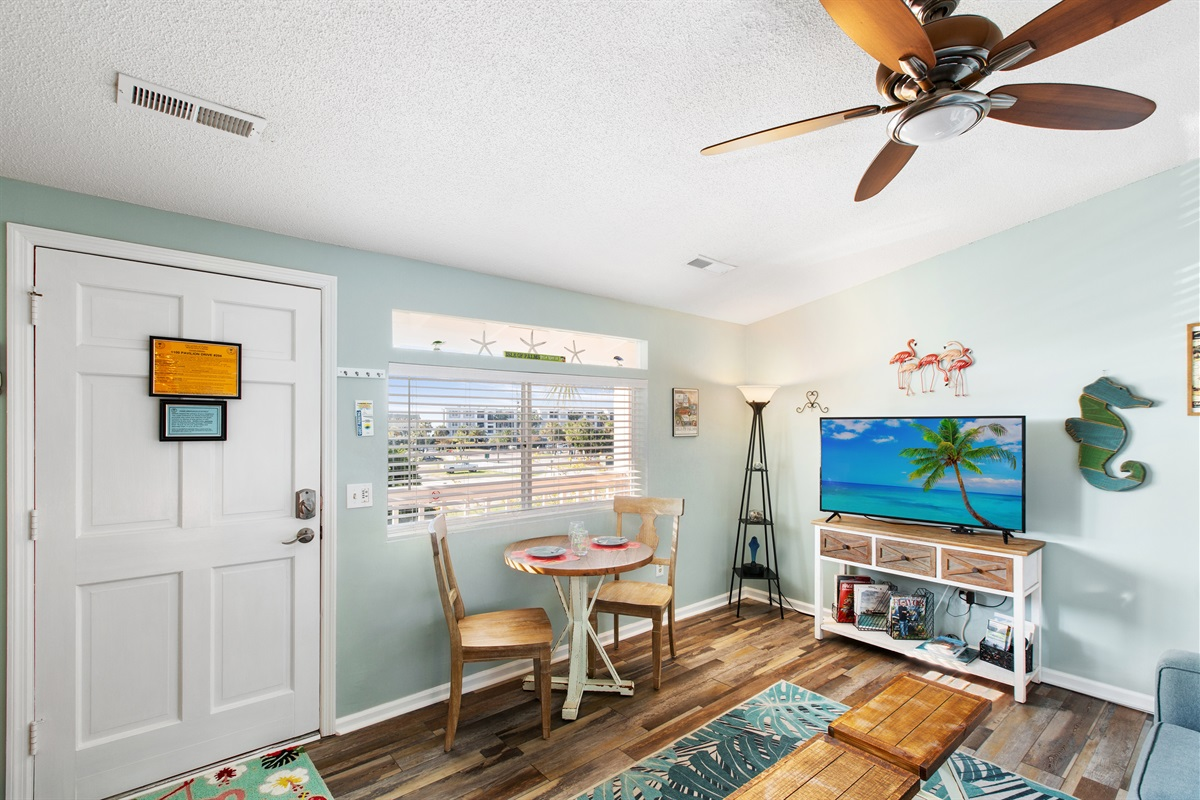 """1Br 1Ba located on the front of the building overlooking parking with an """"ocean peek"""" of the ocean a short block away.  View from the bedroom balcony"""