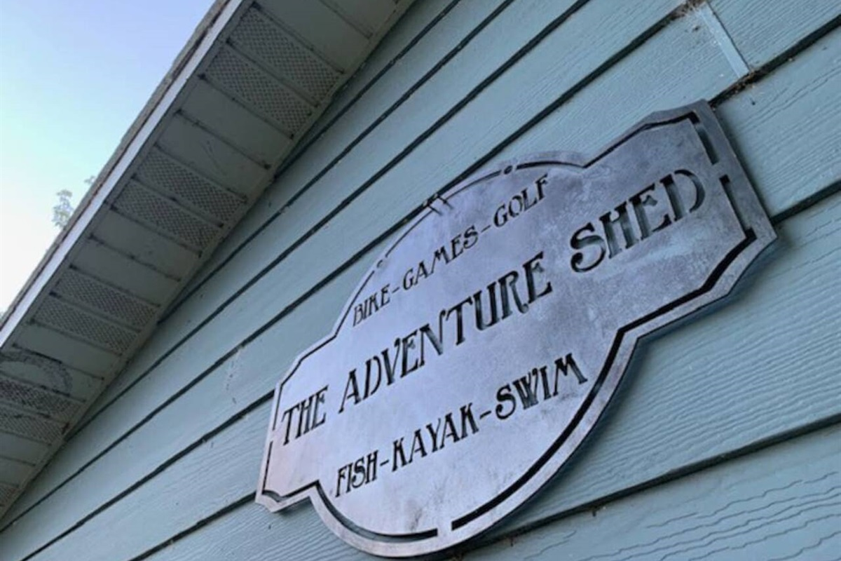 """The Adventure Shed"" is FILLED with bikes, games, 3 golf sets, 8 fishing poles and gear, 4 kayaks/paddles, swimming equipment like life-jackets, 4 dog kennels, 2 kids strollers, a big wagon, a bunch of footballs/frisbees, bags and washer toss."