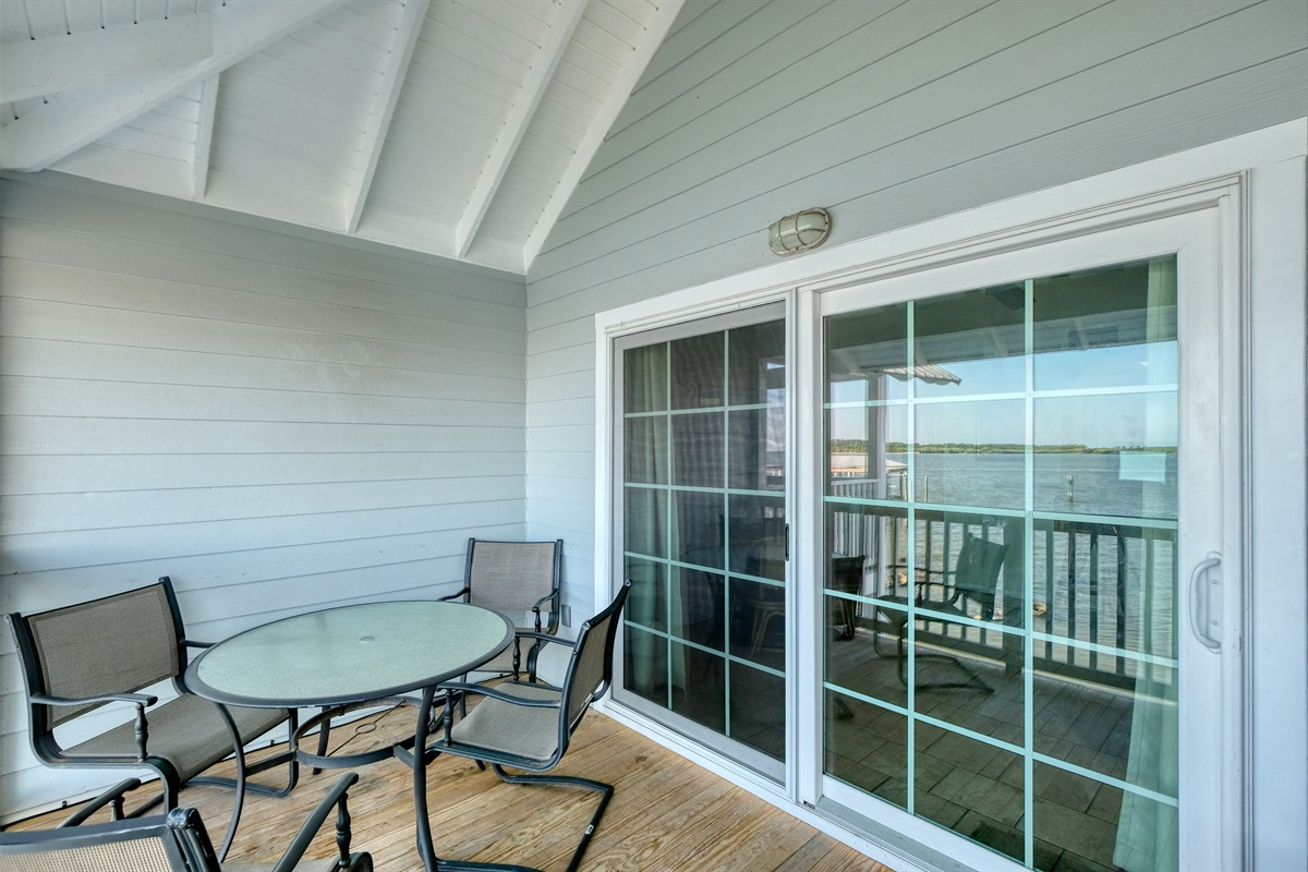 Large sliding glass doors lead to the private porch