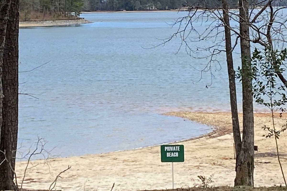 """""""KBE Private Beach/Sand Area"""". Good place for """"Tweens"""" to get in the Water for a Game of Marco Polo. Grab your Lawn Chair & a Good Book for a Day in the Sun!"""