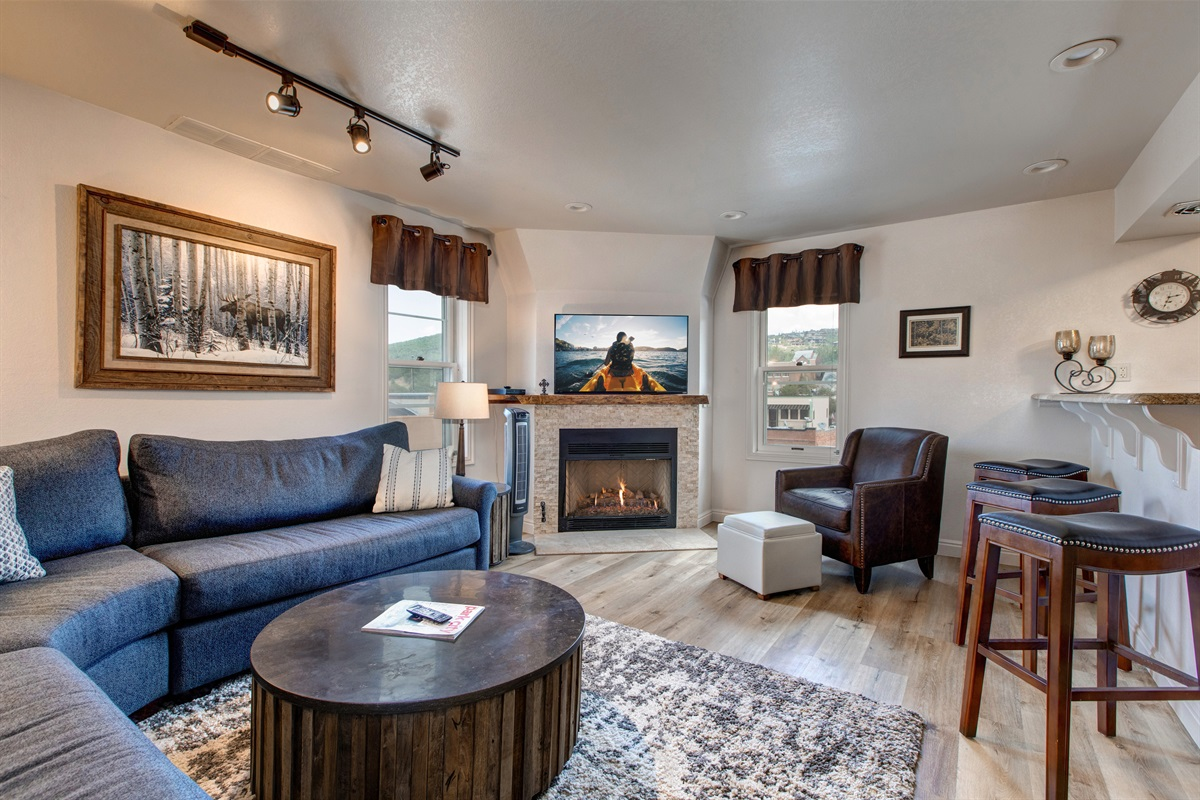Living area with gas burning fireplace, dining, kitchen
