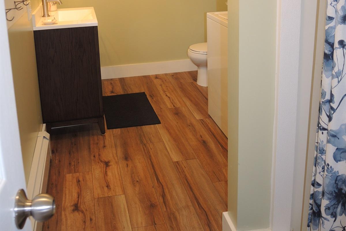 1st floor full bathroom off of the kitchen w/ Washer & Dryer