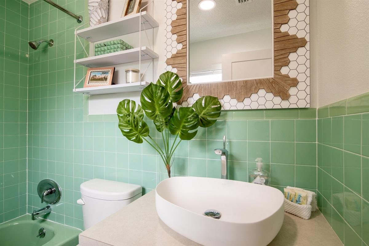 Bathroom has restored 1960's vintage green tiles