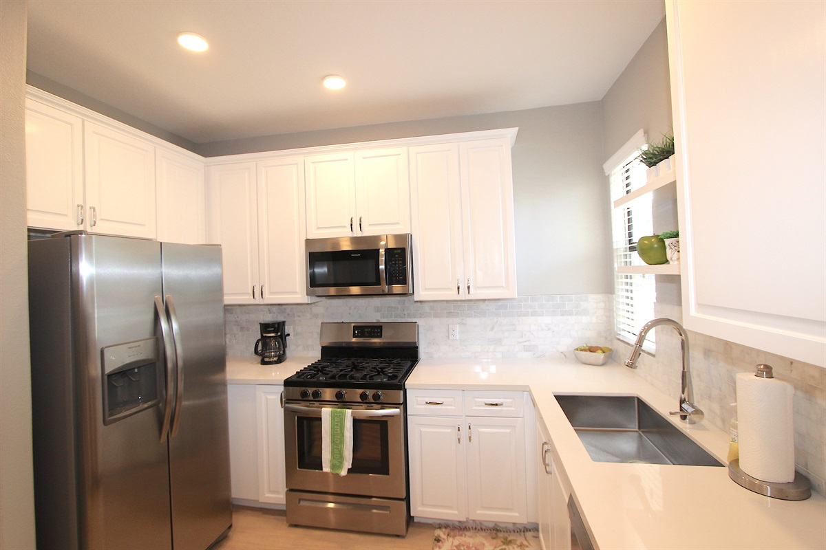 Updated kitchen with stainless steel appliances.