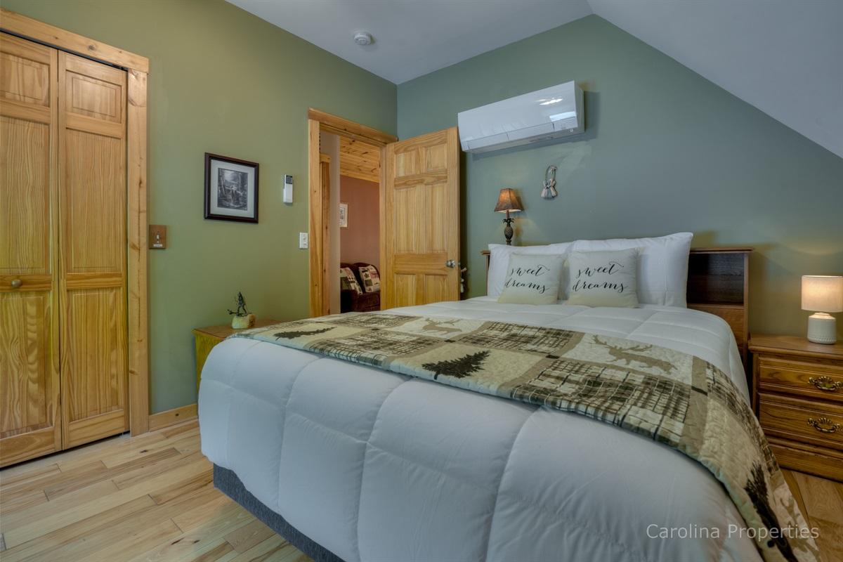 Upper level bedroom with queen size bed