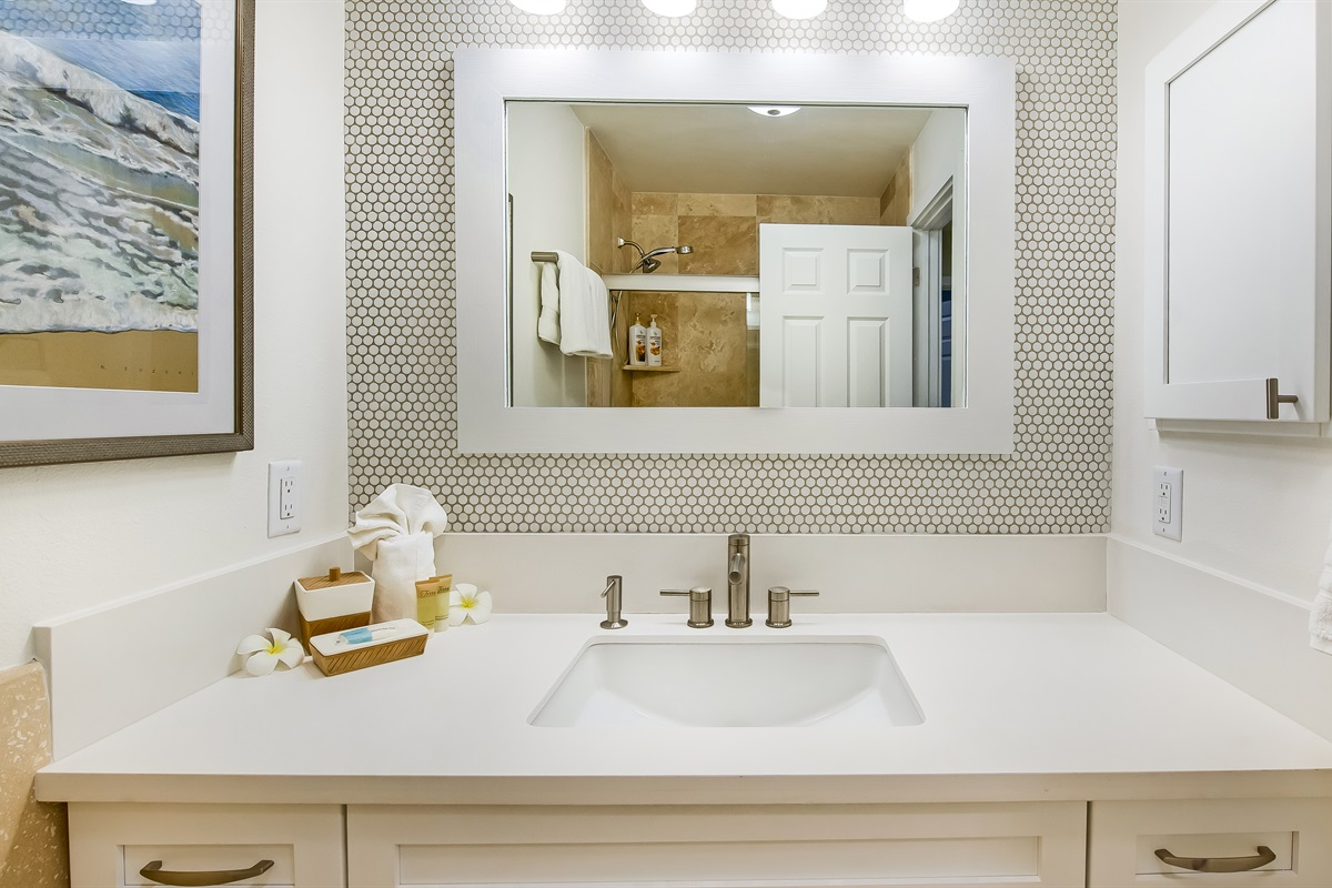 Bathroom #2, remodeled quartz counters, penny tile. Lots of extra toiletries.