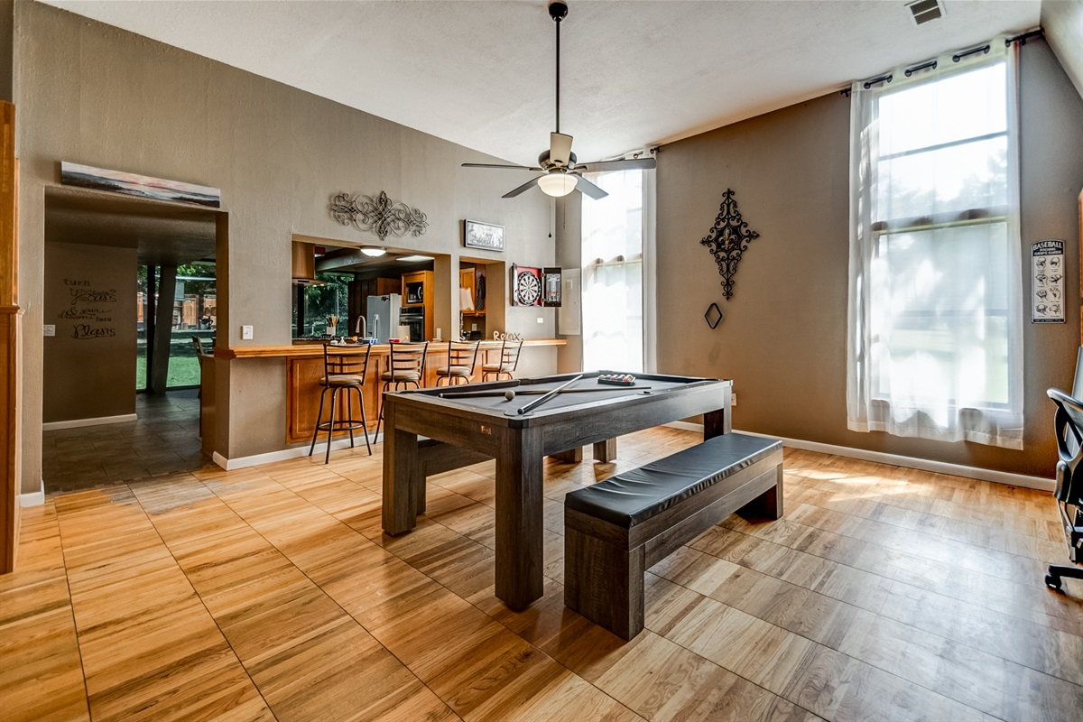 Turn the dining room into a pool hall with bar stools and a dart board!