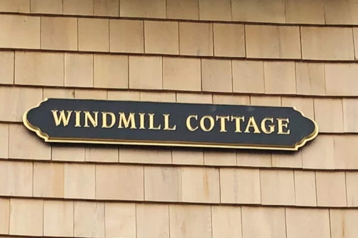 Classic Cape Cod style quarterboard although there is no mistaking which building is the Windmill Cottage!