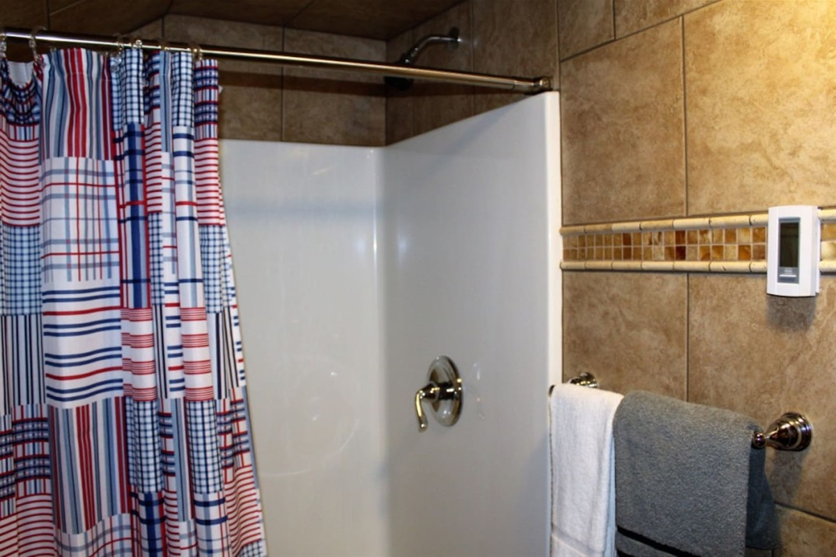 Bathroom off bedroom #3, main level, with stall shower and separate lavatory area