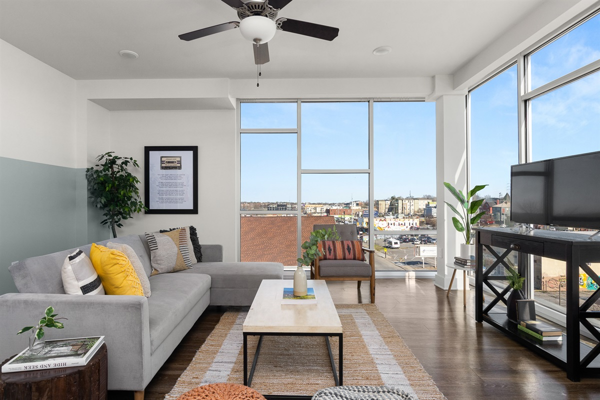Comfortable living room with floor to ceiling windows!