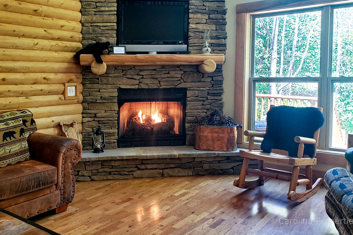Cozy gas log fireplace in the open living room