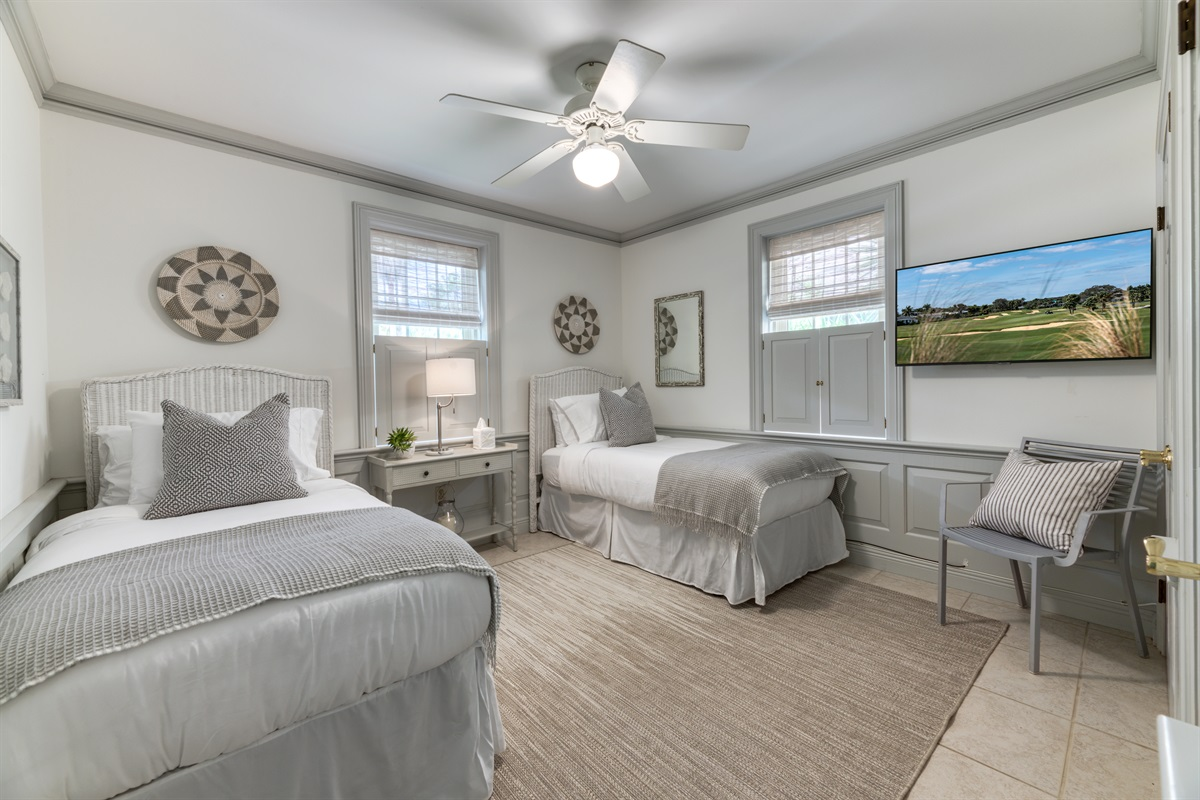 2nd Bedroom is so inviting! Beautiful hues of light greys and clean whites. The room has 2 very comfy twin beds and a Smart App TV. Great closet space too! The closet also holds an iron and board and pack n play with sheet.