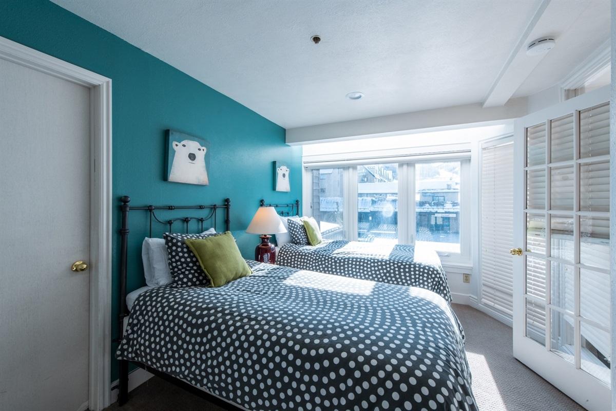Bedroom 2. Twin beds overlooking the ice rink below. Separate walk in closet.