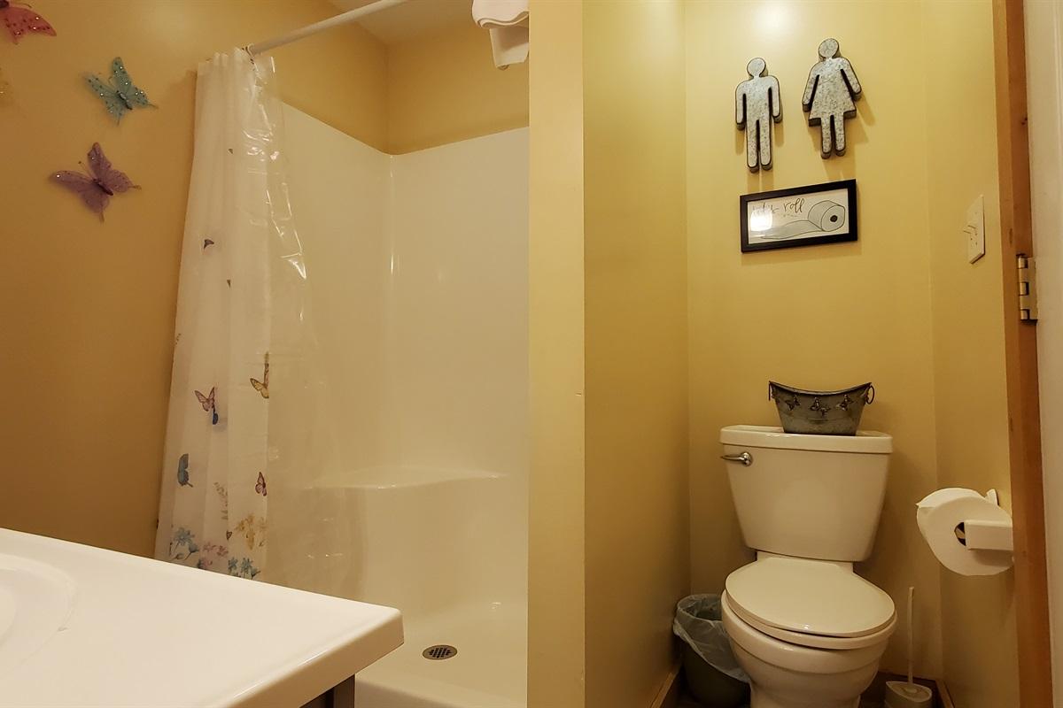 Full bath located upstairs beside twin bedroom