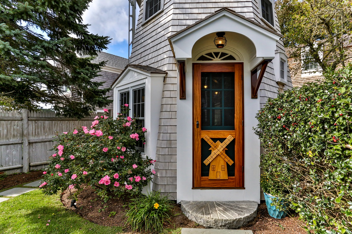 Warm and inviting private entrance with a mahogany screen door designed with the windmill motif. No mistaking this famous building!