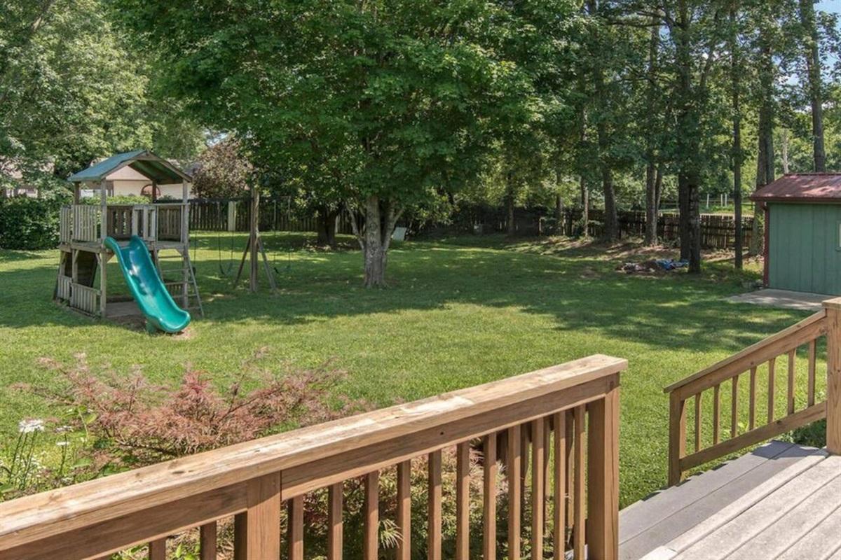 Huge backyard with playhouse
