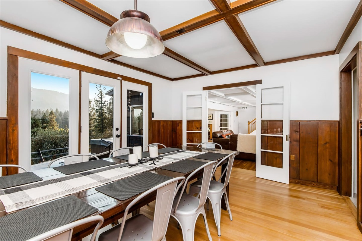 Dining Room (Lower Level): Large indoor dining table with room for 8 is located near the living room.