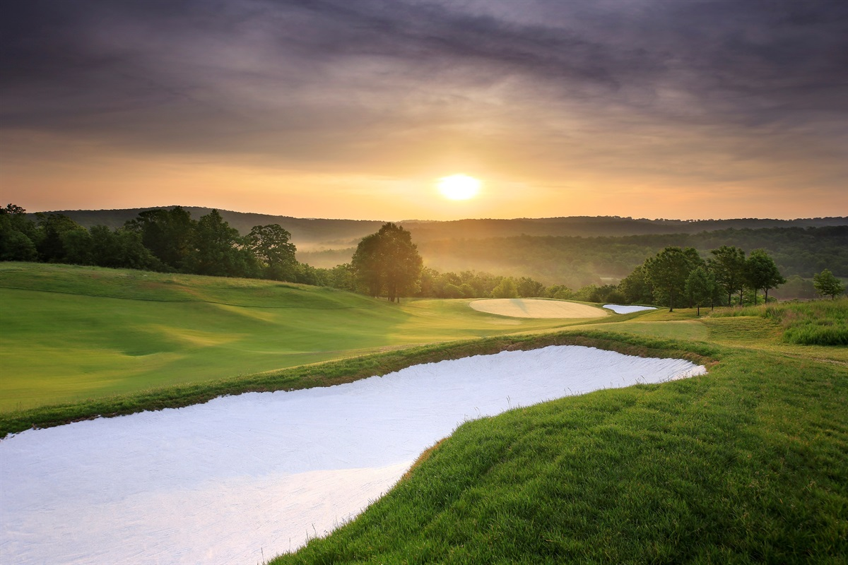 Enjoy gorgeous views over green-covered mountains from the golf course! (BCVB)