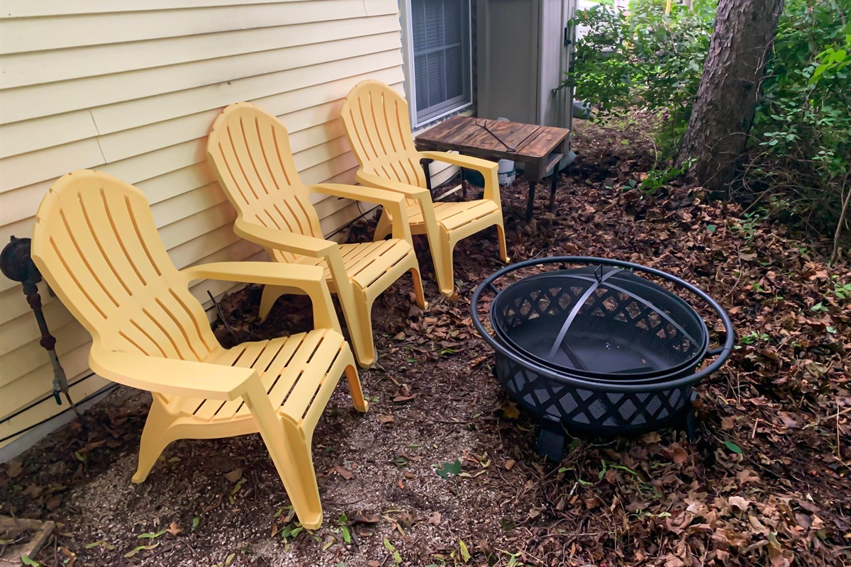 Enjoy sitting around the fire pit in the back yard next to the woods. We have 6 chairs and a firepit ring. Buy firewood just down the street.